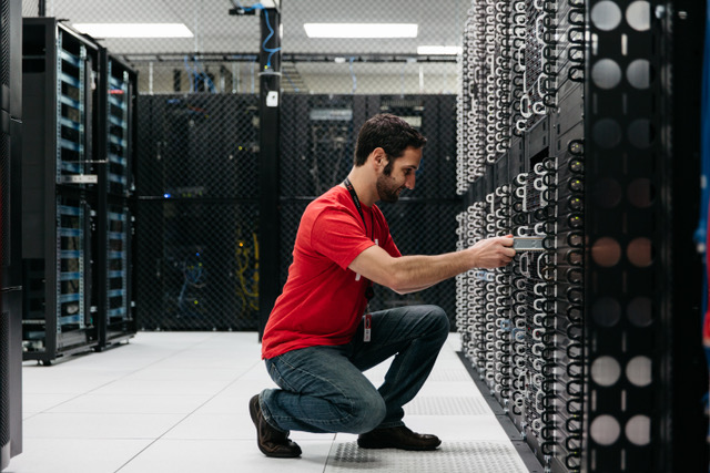 A Hivelocity employee installing a server into a rack