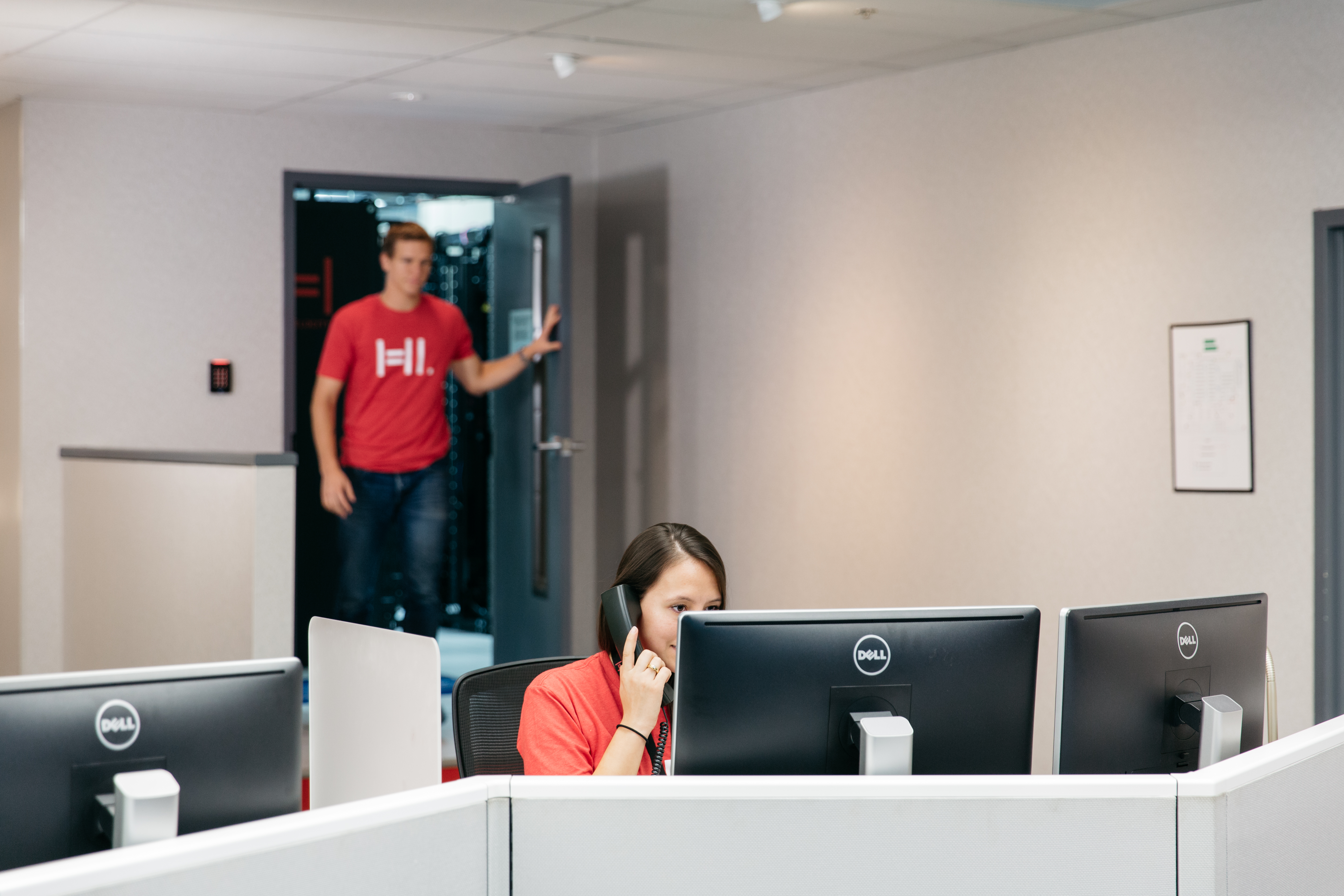 Hivelocity employees assisting a customer over the phone
