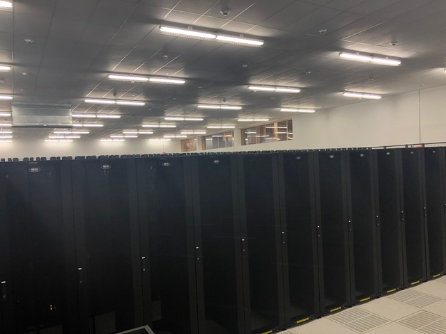 A room filled with rows of server cabinets