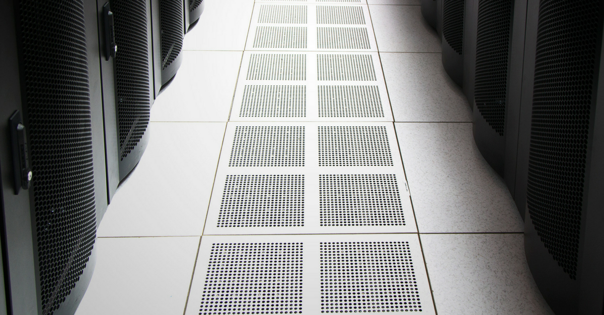 Cooling vents in the floor beneath rows of server cabinets