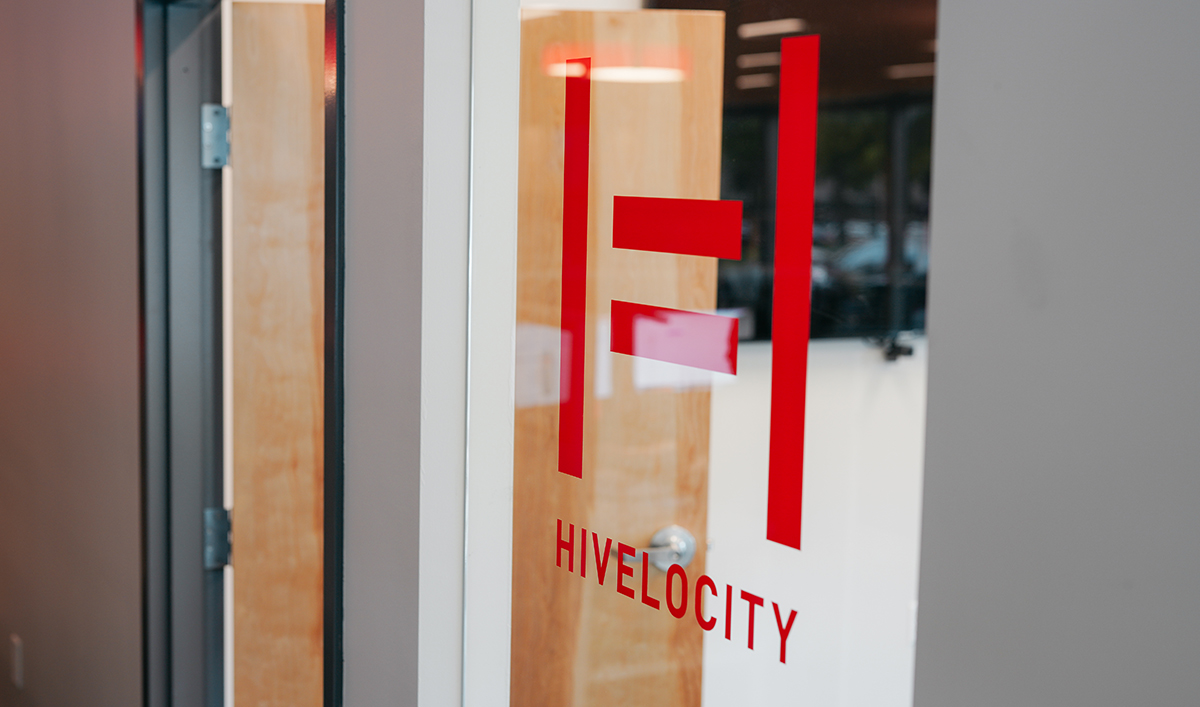 A windows featuring a decal of the Hivelocity logo