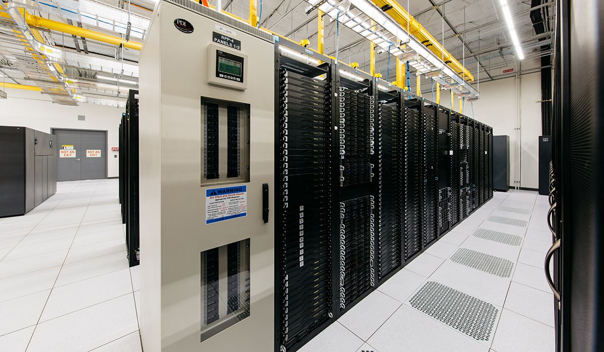 Server room with cabinets filled with servers